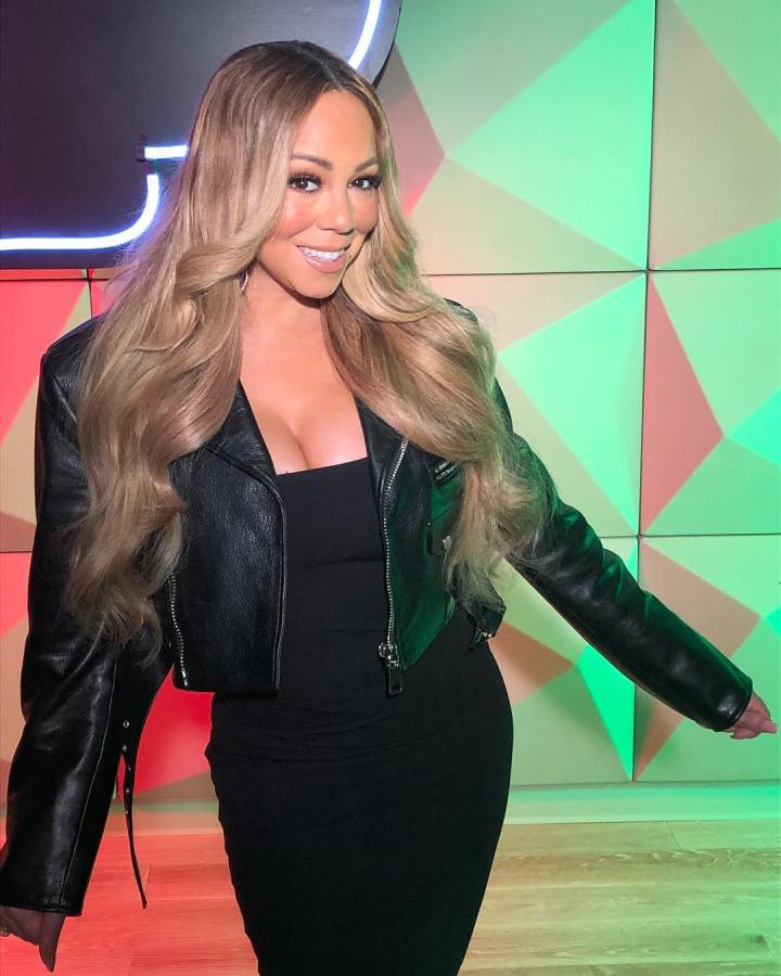 Mariah Carey's assistant sues, claiming manager butt slapped, used racistlanguage